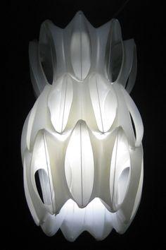 Recycled fabric softener bottles make an elegant lamp by lighting designer Heath Nash.
