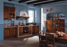 Idea of the Day: An Italian kitchen with golden-brown cabinets, blue walls, and wood ceiling breams. By Latini Cucine. Kitchen Stove, Kitchen Cabinets, Kitchen Colour Schemes, Color Schemes, Kitchen Cabinet Manufacturers, Brown Cabinets, Wood Ceilings, Updated Kitchen, Golden Brown