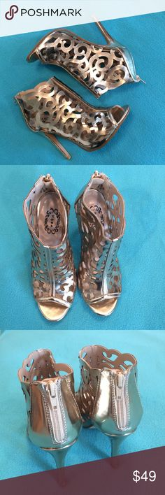 """NWOT-N.Y.L.A.-size 7, gold scroll cutout heels NWOT-N.Y.L.A.-Brand new, never worn, size 7, stunning, metallic gold, scroll cutout heels in the style """"Hansel"""".  Zipper closure on heel. Heel height is approx. 4.5 inches. All man made materials. Box not included. N.Y.L.A. Shoes Heels"""