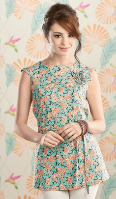 This loose-fitting tunic top is perfect for summer, made in your favourite quilting cotton. If you'd prefer a cami top, simply use the shorter cutting lines on the pattern to find the perfect hem line for you. You can customise your look further with a tie belt and pretty fabric corsage.