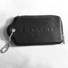 Coach handtag leather case Black leather. Zip closure. Two credit card spaces inside. Black cloth interior. Great for phone- Would hold iPhone 5 or similar. Coach Accessories Phone Cases