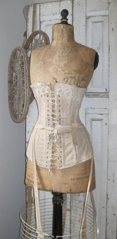 tailors dummy with corset.  Repinned by www.silver-and-grey.com