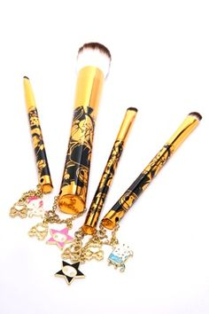 Tokidoki 24 Karat Brush set. Could do without the charms but, Yes. #makeup