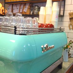 Custom powder coated SMEG green FB80 La Marzocco to match the fridge @ Cupcake Central
