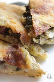 tipico piatto della tradizione campana...la pizza di scarole...   le dosi sono indicative...dovreste regolarvi un po' perché non posso ...