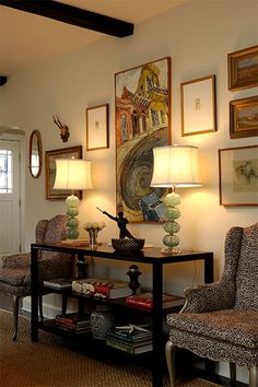Love the arrangement of furniture, lamps, pictures