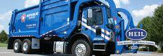 Heil's Load Control. Half/Pack front loader garbage truck