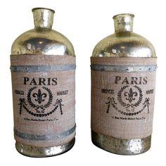 Beautiful pair of mercury glass bottles  Unknown  20th century  Pair of Decorative mercury vases