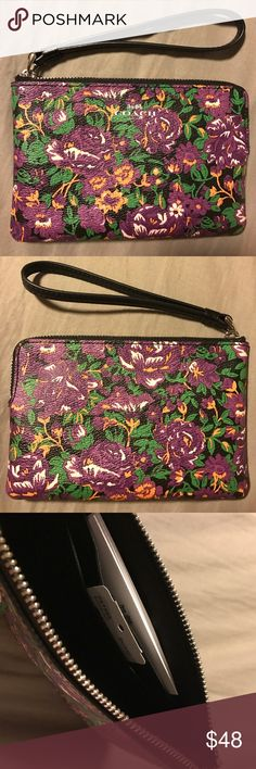 Coach purple floral wristlet Gorgeous purple all over floral print coach wristlet. Interior & wristlet strap is black. Inside has two slit pockets on one side. Silver zipper hardware & silver coach brand name on front. Coach Bags Clutches & Wristlets