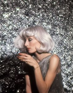 gray hair . Anjelica Huston, 1976  Stylist: Ara Gallant