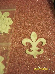 paper punches  100 fleur de lis  by PaperCraftingByMandy on Etsy, $3.99