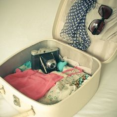 all you need to travel with; sunglasses, camera, lingerie, swimsuits