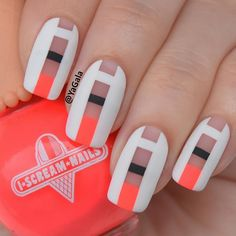 This simple yet eye-catching design mixes simplicity and creativity. Although the design isn't that much, this is a unique nail art design. The screaming orange nail polish also gives it a major boost.