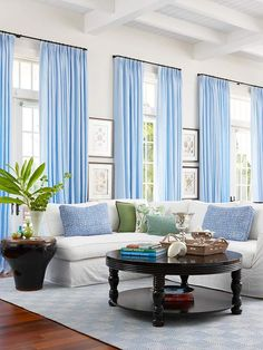Contrast all-white walls with bright accents. How pretty are these blue curtains? Blue, blue, blue--so calming.