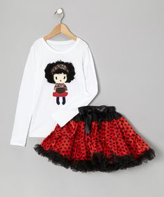 This playful pairing is ready for a full day of fun. The comfy cotton tee shows off a sweet doll graphic with 3-D hair, and the poufy pettiskirt is trimmed with flouncy ruffles and tied with a bow. Includes tee and pettiskirtTee: 100% cotton