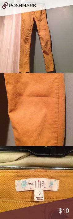 Skinny Jeans Mustard colored skinny jeans. Size 3. 63% cotton 34% Polyester and 3% Spandex love fire Pants Skinny