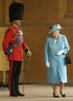 The Queen laughing at her husband, Prince Phillip, dressed as a palace guard. These two really do love each other.