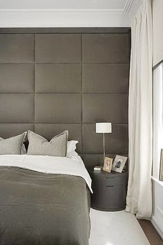 upholstered back wall of master bedroom