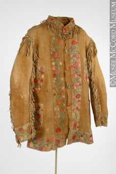 Coat  Anonyme - Anonymous  Eastern Woodlands  Aboriginal: Anishinaabe (Chippewa)  1875-1900, 19th century  Tanned and smoked hide, silk embroidery floss, metal buttons, cotton thread