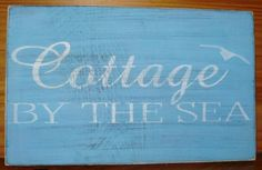 """Here is a brand new one! """"Cottage by the Sea"""". It is premium wood that measures approximately 6"""" x 12"""". I painted it Aqua with lettering in Ice White.I have aged to give it an old primitive look and sealed it with satin glaze. It will come to you signed and dated by me. Pick your colors. Just message me and let me know any color you'd like!"""