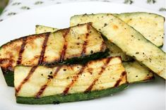 Grilled zucchini... I love doing the same thing with eggplant and squash. Garlic, olive oil and Parmesan = can't go wrong (great news for me)