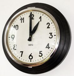 Vintage Industrial Factory Clock by AEG, logo designed by Peter Behrens. 1950s.