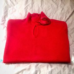Cashmere Keyhole Sweater w/Rhinestone Detail NWT. Never worn.  Very feminine,  lipstick red, 100% cashmere sweater with red material floral detail over keyhole neck and button-up turtle.   Rhinestones along the bottom of the sleeves.  Purchased from Neiman Marcus but was always too small for me.  ❤️Give it the love it deserves! ❤️ Neiman Marcus Sweaters Cowl & Turtlenecks