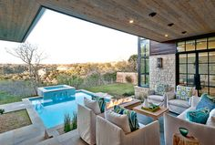 Swimming Pool View Open Plan Living Room Reshaping Design Through Lighting: Cozy Luxury Home by Cornerstone Architects