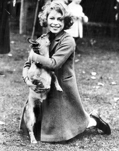 Queen Elizabeth, although at the time this photo was taken not yet Queen, and her first Corgi Susan in 1937.