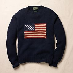 Ralph Lauren. Hand-Knit Wool Flag Sweater. When asked to sit for a Life Magazine photo shoot, Ralph Lauren created this iconic design. It's popularity led to an entire line of flag-inspired products. Circa 1989. Hand-knit in a hearty jersey stitch with a large American flag detail at the chest. Ribbed crewneck collar, cuffs and hem. 100% wool.