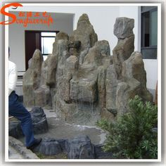 Source China high quality large stones garden fountains fake marble stone for garden fiberglass rock waterfall rockery landscape on m.alibaba.com