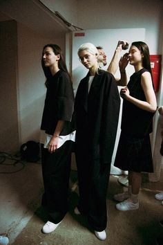 Back stage at Jacquemus AW14, I love the baggy loose layers teamed up with the Adidas superstars.