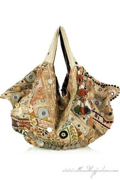 Simone Camille shoulder bag has two top handles, pompom and bead embellishment, coin, mirror, two internal compartments, a zip-fastening pocket inside, push-stud fastenings to expand and is lined in multicolored printed cotton. Designer color: Nude