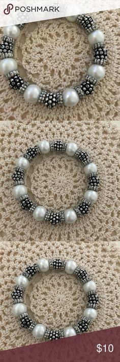 Dressbarn elastic bracelet Dressbarn silver colored, black and white elastic bracelet. Elegant. Can be worn day or night! Dress Barn Jewelry Bracelets