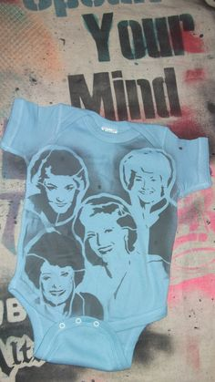 funny baby onesie gift The Golden Girls TV hand stenciled light blue by Rainbow Alternative on Etsy. $12.00, via Etsy.