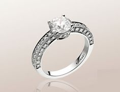 503 solitaire engagement ring in platinum with round brilliant cut diamond and pavé diamonds.