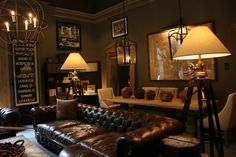 vignette design: The San Francisco Restoration Hardware Gallery -- Love the lighting the green wall, the masculine style