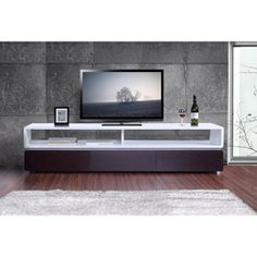 @Overstock - This modern TV stand features a sleek design with a brown oak veneer. White high-gloss accents and three media drawers complete this contemporary stand.http://www.overstock.com/Home-Garden/Venezia-Brown-Oak-White-Three-drawer-TV-Stand/5878099/product.html?CID=214117 $908.99