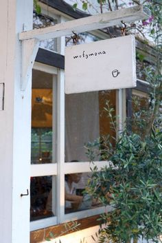 cute, simple, if sign is too block white it might look dirty so perhaps natural or a light white wash over grain is better long term? Café Restaurant, Restaurant Design, Cafe Interior, Interior Design, Cafe Shop Design, Little Paris, Café Bar, Cafe Style, Shop Fronts