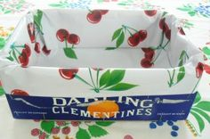 Clementine box re-do, only mine would have a darker (maybe halloween themed) fabric and painted black.