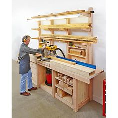 """Store lumber, cut it to length, shape and assemble it, and organize supplies in one super station. Dimensions: 94""""H x 29-1/4""""D x 120""""L Featured in WOOD Issue 234, September 2015"""