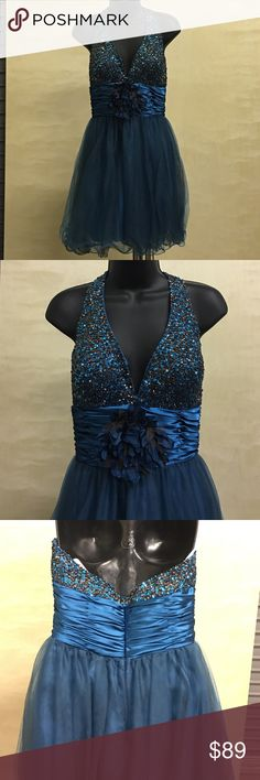 Hannah S Backless Dress Hannah S Backless, Halter top Dress. Beaded top with flower accent. Style#278550 Hannah S Dresses Backless