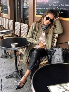 long sweater over leather pants and a pair of pointy shoes
