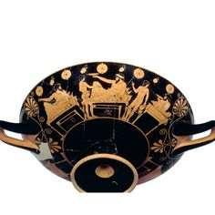"Greek, about 485-480 BC   Made in Athens, Greece; found at Vulci, (Lazio, Italy)    This kylix, or drinking cup, shows an all-male party known as a symposion, which is Greek for ""drinking together"". It is signed by Douris as painter and was found in a tomb in Italy in a region that was then inhabited by the Etruscans.  -British Museum"