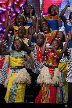 The Watoto Choir from Uganda proceeds to the stage at Bread for the World's 2011 Gathering in Bender Arena at American University on Sunday, June 12, 2011.    Photo by Rick Reinhard