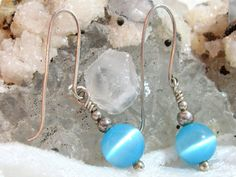 Baby Blue Earring, Baby Blue Fiber Optic Earrings, Solid 935 Sterling Silver Wire Wrapped in Argentium Anti Tarnish wire by JewelrybyPatterson on Etsy