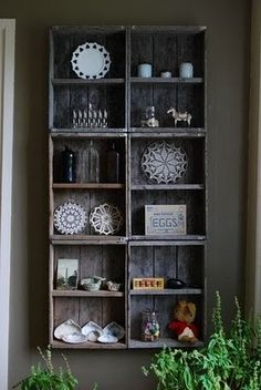 Crates repurposed as shelves, reminds me of a beautiful Window Shelf I saw at Artefacts in St. Jacobs