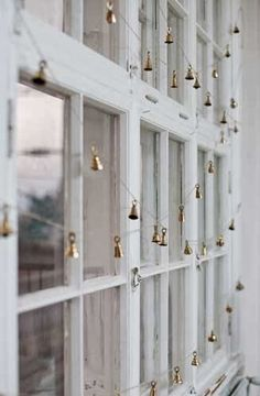 I think I just found my Fav....; sweet tiny brass bells as window garland, can just imagine how lovely they sound when the wind blows!..... love it!