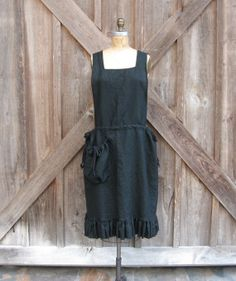 linen jumper pinafore apron dress tunic in black. This pinafore is the perfect piece with sides that have adjustable drawstrings. A pocket with drawstrings adds the final touch. Perfect to layer over a dress, skirt or bloomers and a tee...looks great over jeans too.