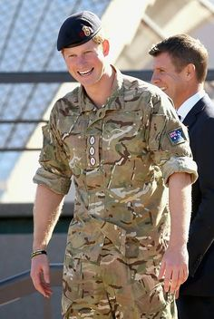 Prince Harry laughs during a walkabout outside the Sydney Opera House on May 7, 2015 in Sydney, Australia.